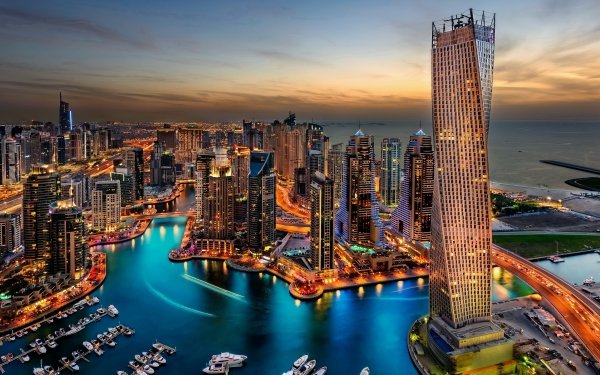 Man Made Dubai Cities United Arab Emirates Cityscape City Evening Light Boat Building Architecture HD Wallpaper | Background Image