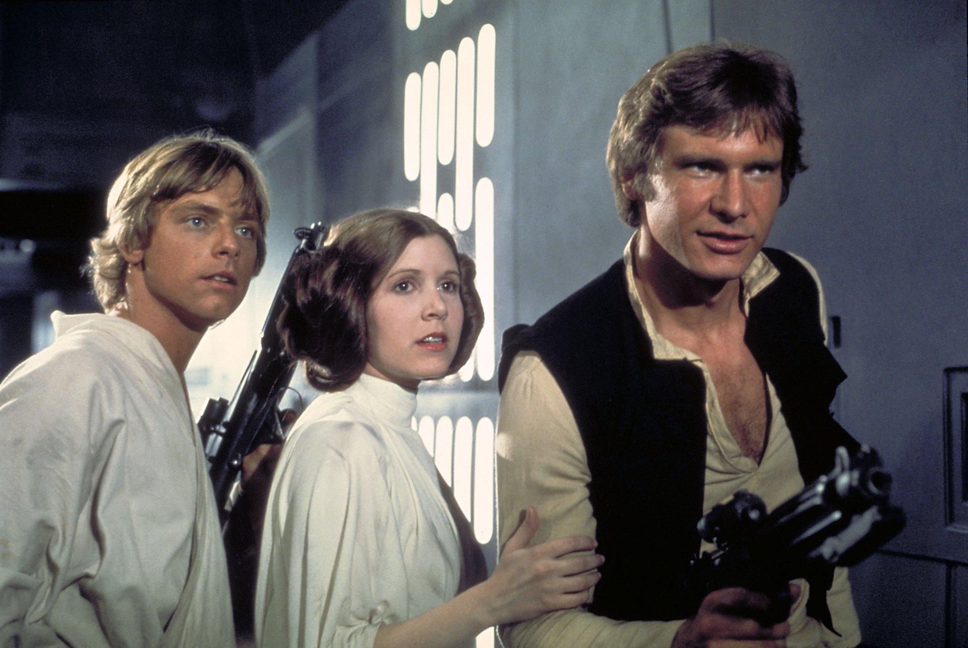 Movie - Star Wars Episode IV: A New Hope  Han Solo Princess Leia Luke Skywalker Wallpaper