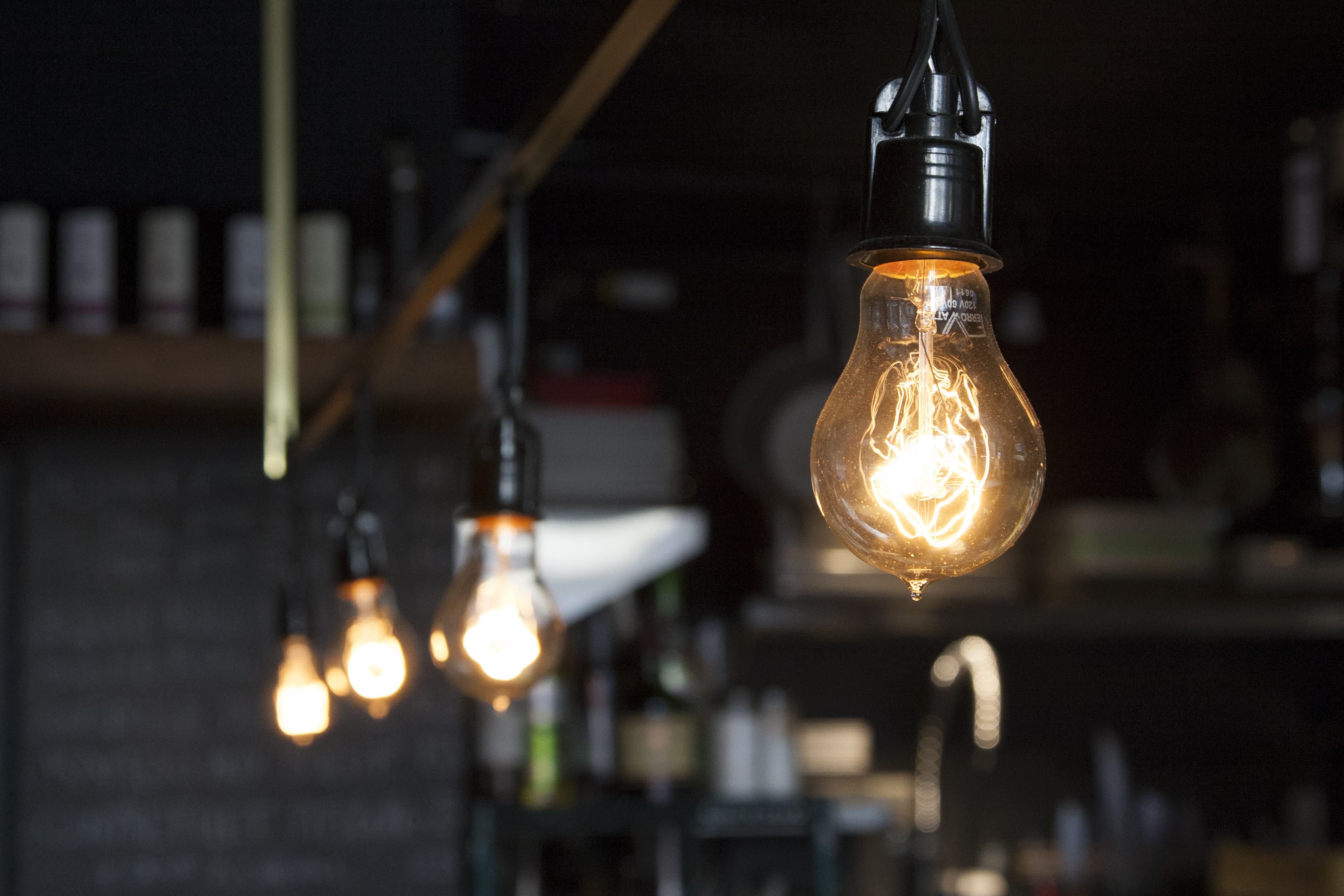 Light Globs Hanging In A Coffee Shop Hd Wallpaper